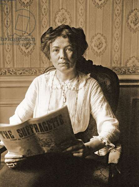 Portrait of C.H. Pankhurst reading The Suffragette Newspaper, 1912 (photo)