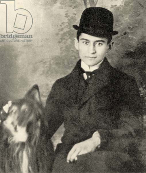 Franz Kafka with his dog, 1910 (b/w photo)