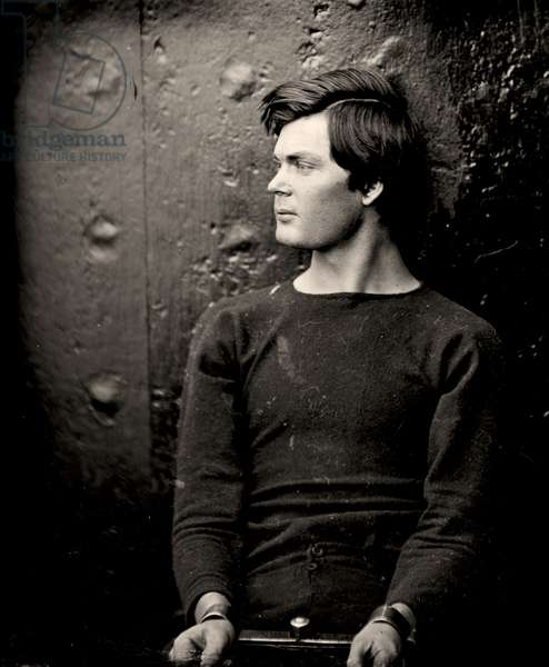 Lewis Powell in wrist irons aboard the USS Saugus, 1865 (photo)