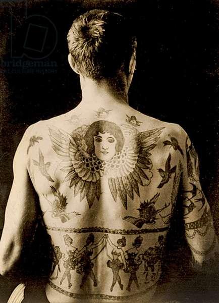 Portrait of a man with an elaborate back-piece tattoo c.1910 ( b/w photo )