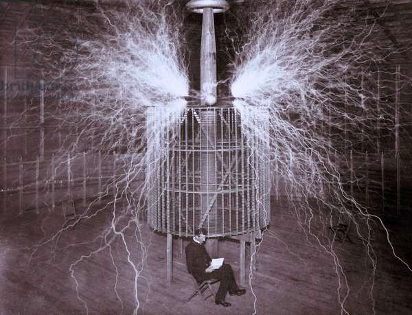 Tesla with his high voltage generator producing bolts of electricity. 1899 (photo)