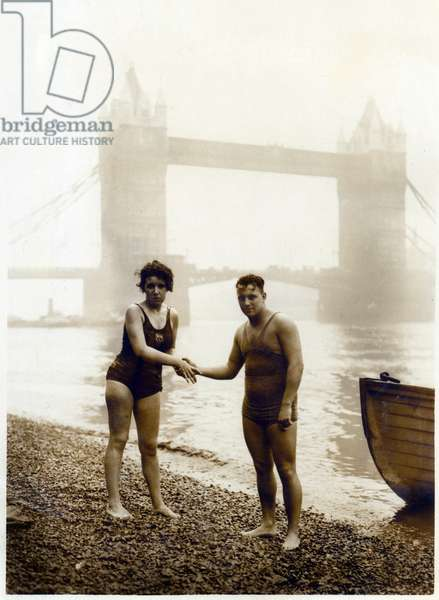 Agnes Nicks being congratulated by Harry Rogers at Tower Bridge, London (photo)