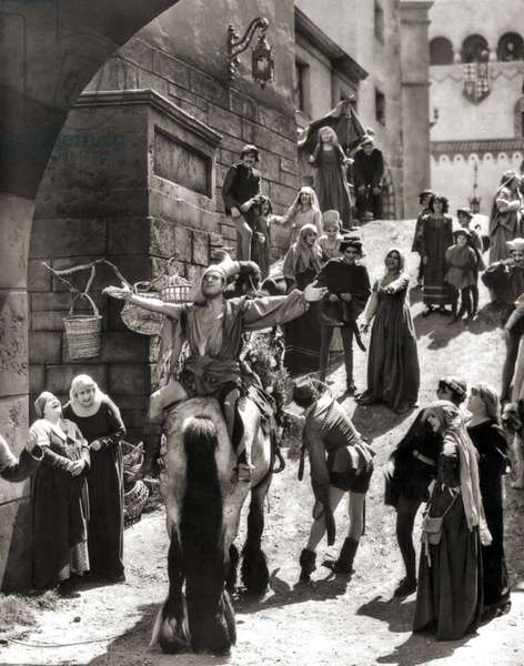 """Douglas Fairbanks senior playing Petruchio as he rides into town facing backwards on a jackass, """"The Taming of the Shrew"""" 1929 (b/w photo)"""