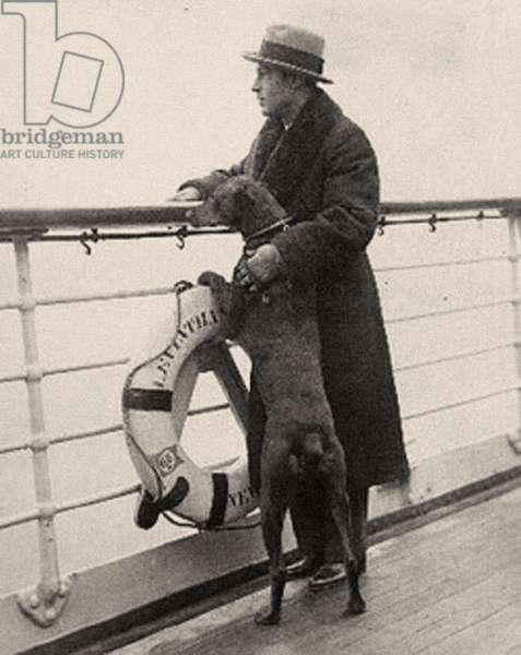 Portrait of Rudolph Valentino (1895 – 1926) and his doberman Kabar at sea. (b/w photo).