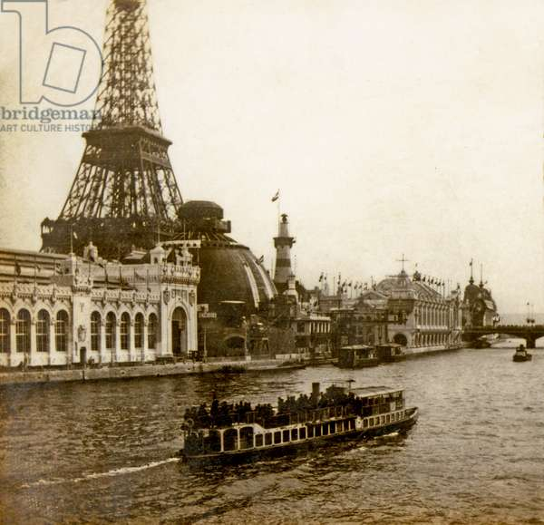 View of the Exposition Universelle, Eiffel Tower, Territorial and Navy Armies Pavilion, Schneider Pavillon, Commercial Navigation Pavillon from the Seine, Paris, France. 1904 (photo)