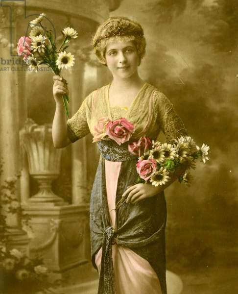 Portrait of a woman holding a bunch of flowers  c.1898 (hand-tinted photo)