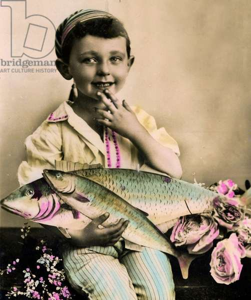 Portrait of a boy holding a fish  c.1898 (hand-tinted photo)