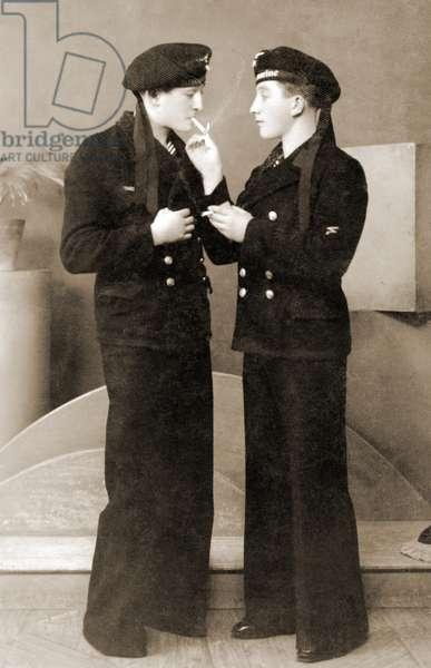 Two German submariners enjoying a cigarette, c.1941 (sepia photo)
