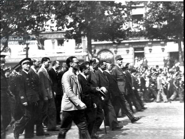 General Charles de Gaulle (1890-1970) marching down the Champs-Elysees, 26th August 1944 (b/w photo)