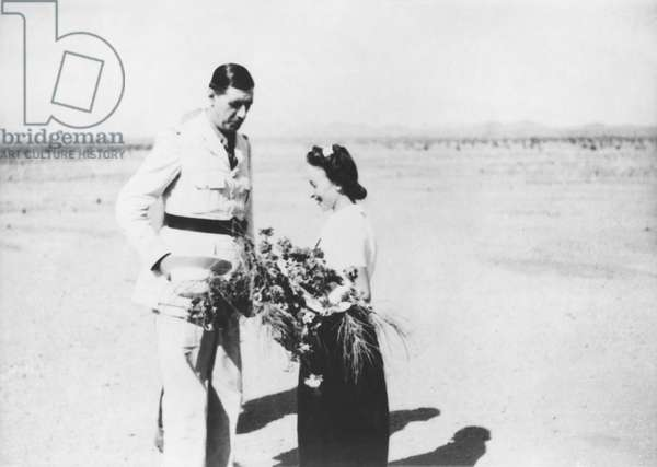 Young woman offering a bunch of flowers to General Charles de Gaulle (1890-1970) Fort Archambault, Oubangui-Chari, Africa, 1940 (b/w photo)