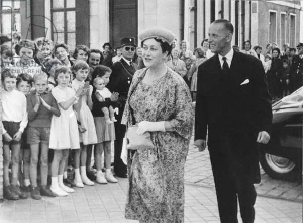 Madame Yvonne de Gaulle (1900-79) and her brother Jacques Vendroux (1897-1988) arriving at the maternity home, rue Verte, Calais, 24-27th July 1958 (b/w photo)