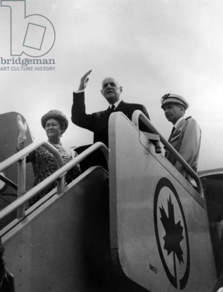 General de Gaulle, Yvonne de Gaulle and Lieutenant-Colonel de l'Air Degrées du Lou, on the steps of the aeroplane on the visit to Montréal, July 1967 (b/w photo)