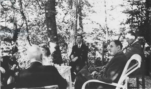 Lieutenant Philippe de Gaulle (b.1921) his wife Henriette de Montalembert, Commandant Alain de Boissieu (b.1914) General Charles de Gaulle (1890-1970) Father de Dartein in the garden at La Boisserie, Summer 1947 (b/w photo)