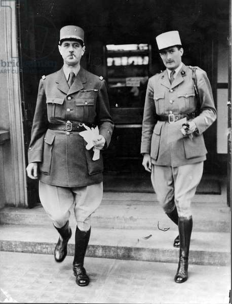 General Charles de Gaulle (1890-1970) and his aide-de-camp Lieutenant Geoffroy de Courcel leaving their headquarters in London, 26th June 1940 (b/w photo)
