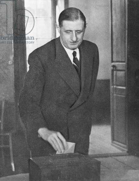 General Charles de Gaulle (1890-1970) voting (b/w photo)