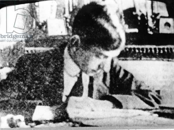 Charles de Gaulle (1890-1970) aged 15 at his desk, 1905 (b/w photo)