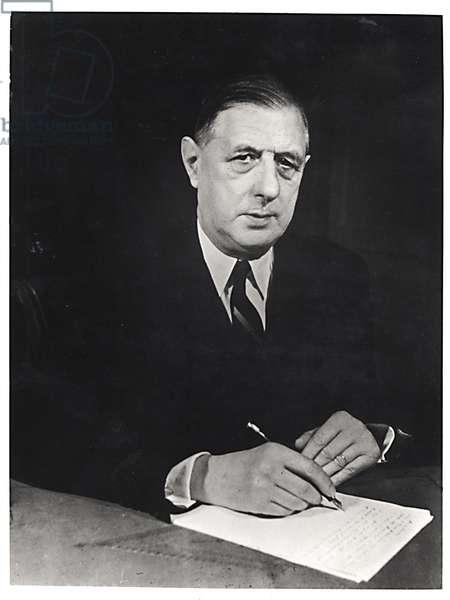 General Charles de Gaulle (1890-1970) writing, 1948 (b/w photo)
