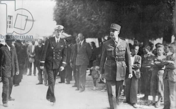 General Charles de Gaulle (1890-1970) Lieutenant Philippe de Gaulle (b.1921) and Mayor Monsieur Valeur, square of Colombey-les-deux-Eglises, 1947 or 1948 (b/w photo)