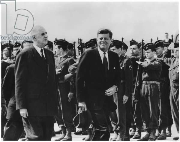 General Charles de Gaulle (1890-1970) and John Fitzgerald Kennedy (1917-63) passing the guard of honour at Orly, 31st May 1961 (b/w photo)