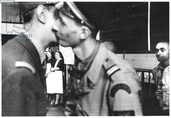 General Charles de Gaulle (1890-1970) and his son Lieutenant Philippe de Gaulle (b.1921) kissing at Montparnasse Station, 25th August 1944 (b/w photo)