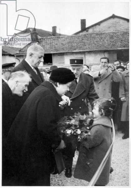 A young girl offering a bunch of flowers to Madame Yvonne de Gaulle (1900-79) at the opening of the village hall in Colombey-les-Deux-Eglises, 1962 (b/w photo)