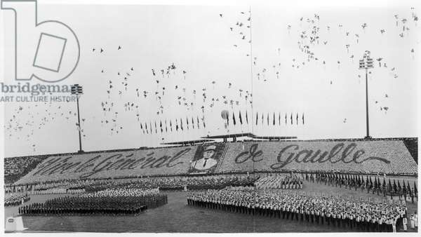 The reception at the stadium during the official visit of General de Gaulle (1890-1970) to Cambodia, 30th August to 2nd September 1966 (b/w photo)