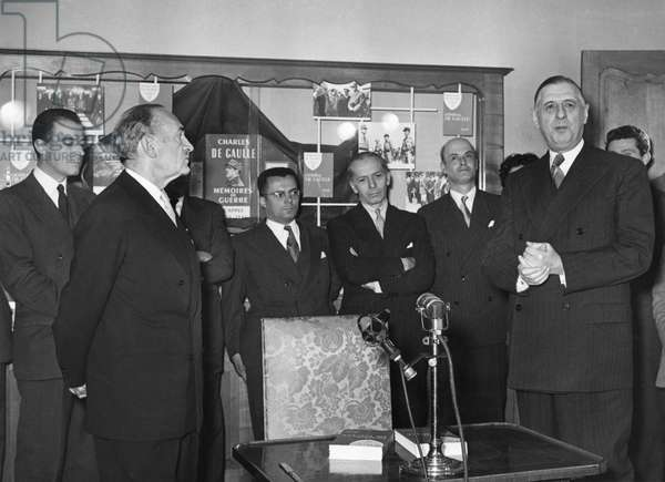 General Charles de Gaulle (1890-1970) presenting the first volume 'L'Appel' of his 'Memories of War', Librairie Plon, 22nd October 1954 (b/w photo)