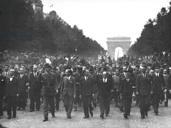 Liberation of Paris, General Charles de Gaulle (1890-1970) marching down the Champs-Elysees, 25th August 1944 (b/w photo)