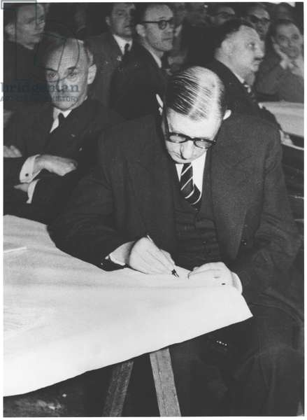 General Charles de Gaulle (1890-1970) writing, at the town hall of Vincennes, during a meeting of the RPF, 1952 (b/w photo)