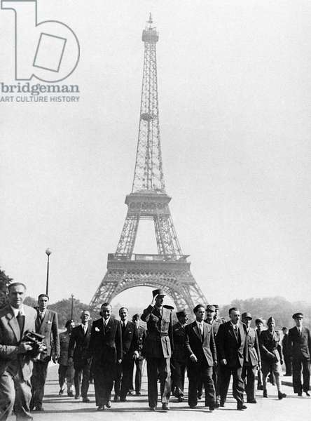 Liberation of Paris, General Charles de Gaulle (1890-1970) marching near the Eiffel tower, 26th August 1944 (b/w photo)