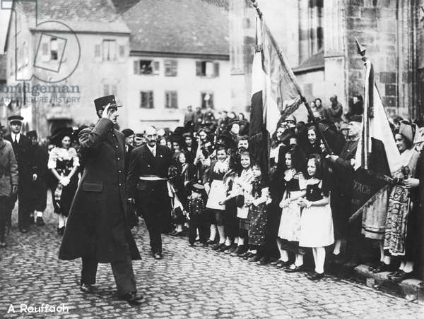 General Charles de Gaulle (1890-1970) parading at Rouffach, Alsace, acclaimed by the crowd, December 1944 (b/w photo)