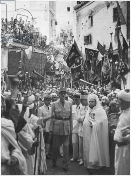 General Charles de Gaulle with General Catroux parading in Fez during his official visit to Morocco, 8th-9th August 1943 (b/w photo)