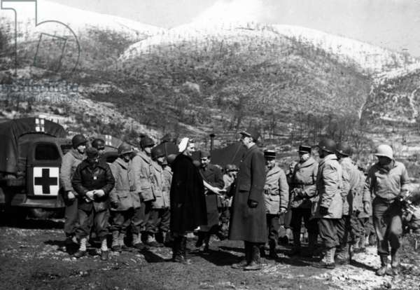 General de Gaulle visiting the French-Italian border, accompanied by Madame de Comtesse du Luart, and inspecting a mobile surgical battalion, 5 March 1944 (b/w photo)