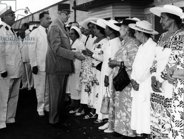 General de Gaulle greeting Miss Gobray, former volunteer of Free France, and the widows and mothers of former French soldiers of Free France killed in combat, Tahiti, 1956 (b/w photo)