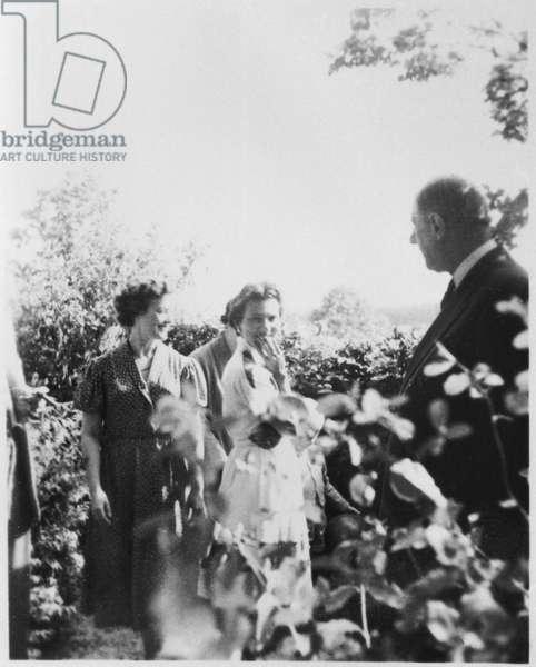 General Charles de Gaulle (1890-1970) and Elisabeth de Boissieu (b.1924) in the garden at La Boisserie, 1952-58 (b/w photo)