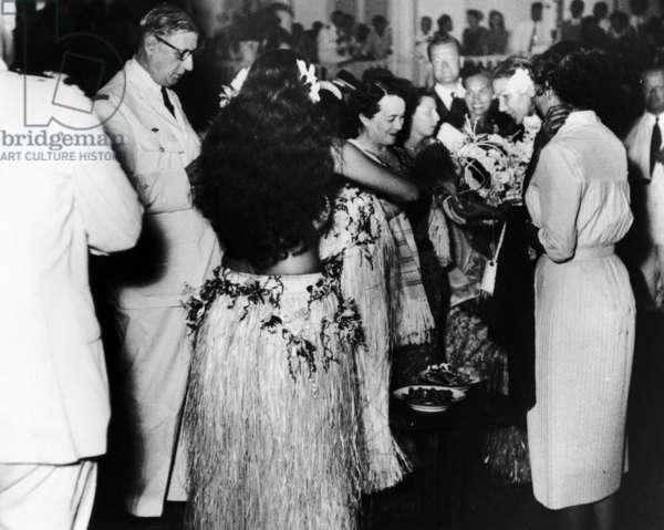 Charles de Gaulle, Yvonne de Gaulle and Olivier Guichard during a reception in Tahiti, 31 August - 2 September, 1956 (b/w photo)