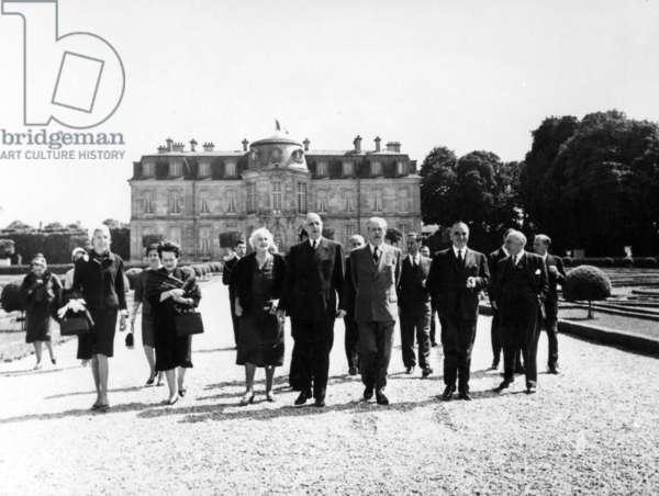 Left to right: Claude Jacqueline Pompidou, Yvonne de Gaulle, Lady Dorothy Macmillan, General de Gaulle, Harold Macmillan, Georges Pompidou, and Pierre Guillaumat, Chateau de Champs sur Marne, 2-3 June 1962 (b/w photo)
