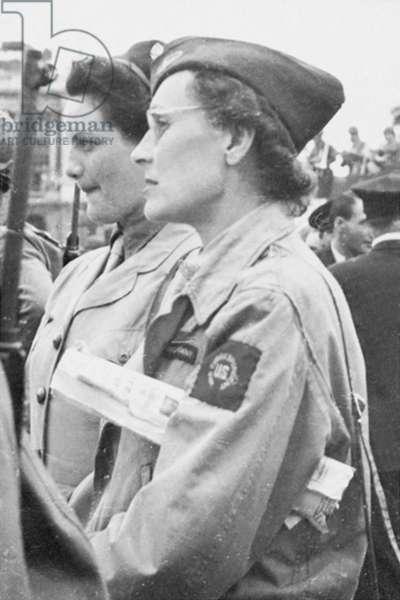 Elisabeth de Miribel and Sonia Tomara watching the parade during the Liberation, Paris, 1944 (b/w photo)