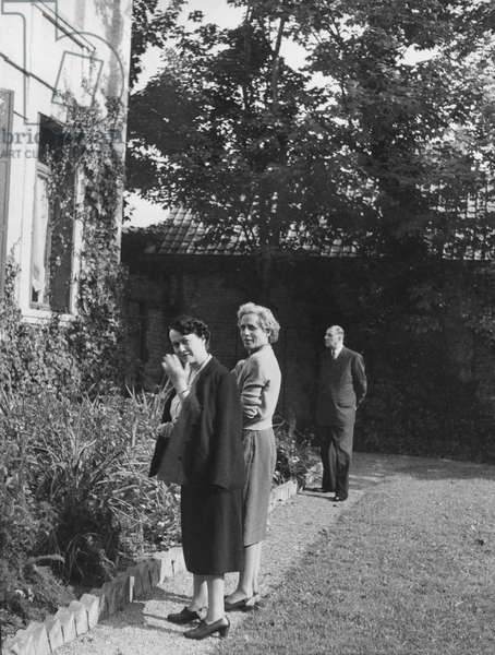Madame Yvonne de Gaulle, Madame Cada Vendroux, General Charles de Gaulle in the garden of Jacques Vendroux at Calais, 1st September 1951 (b/w photo)