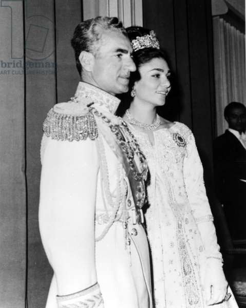 Shah of Iran, Mohammad Rezā Shāh Pahlavi, and his wife Farah Pahlavi, on Charles de Gaulle's state visit to Tehran, October 1963 (b/w photo)