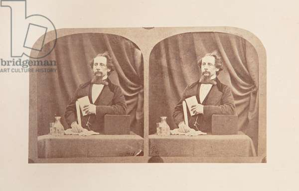 Stereograph of Charles Dickens posed as if reading, 1858 (b/w photo)