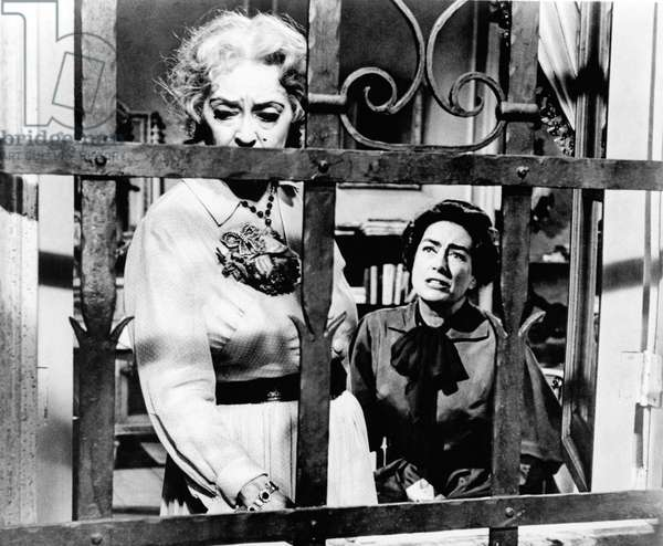 Medium Shot Of Bette Davis As Jane Hudson And Joan Crawford As Blanche Hudson, Sitting In Wheelchair, As Seen Through Window Bars, What Ever Happened To Baby Jane ? Directed By Robert Aldrich