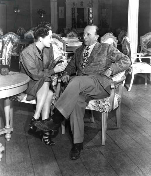Joan Crawford the star of the Mildred Pierce on set with the director Michael Curtiz, 1945 (b/w photo)