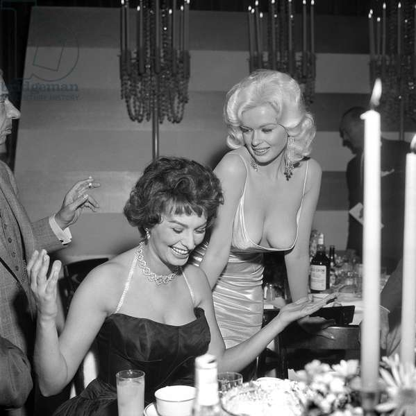 PARTY THROWN BY 20th CENTURY FOX April 12, 1957 California, Holly LOS ANGELES - APRIL 12, 1957: Jayne Mansfield tries to steal the show in a very low cut dress at a party thrown by 20th Century-Fox for Sophia Loren on April 12, 1957 in Los Angeles California (b/w photo)