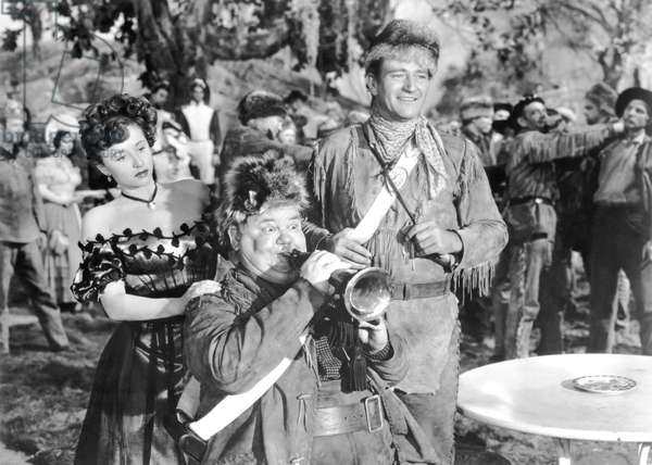 Vera Ralston, Oliver Hardy And John Wayne.