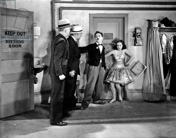 1936: Charles Chaplin (1889 - 1977), And Paulette Goddard (1911 - 1990) Being Threatened By Two Men In Their Dressing Room. Paulette Is Wearing A Ballet Dress. The Film Was Directed By Chaplin. (Photo By Max Munn Autrey)