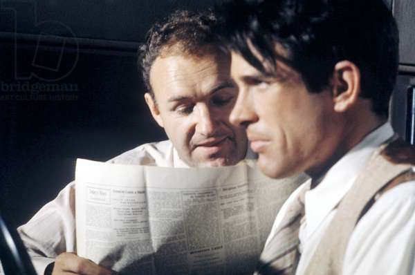 Medium Shot Of Gene Hackman As Buck Barrow Reading Newspaper While Warren Beatty As Clyde Barrow Drives Car