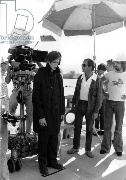 David Bowie and the director Nicolas Roeg during filming of the movie The Man Who Fell To Earth, 1976 (b/w photo)