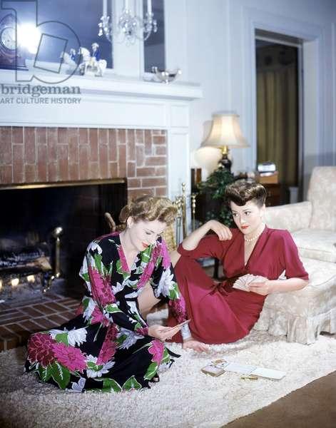 Actress Olivia De Havilland (Right) Plays Cards With Her Sister, Actress Joan Fontaine 1945