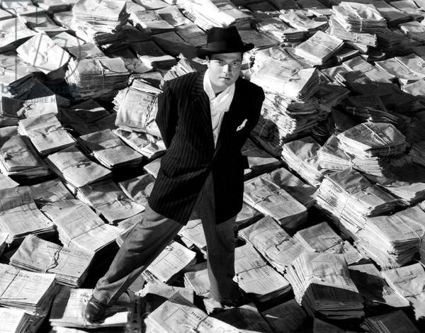 Orson Welles, 1941, Astride Stacks Of Newspaper, Citizen Kane 1941 Directed By Orson Wells